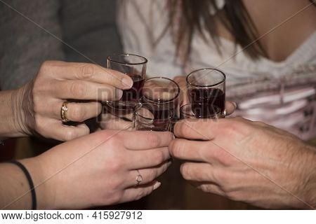 Drinking A Shot Glass Of Schnapps Or Booze; Hard Liquor
