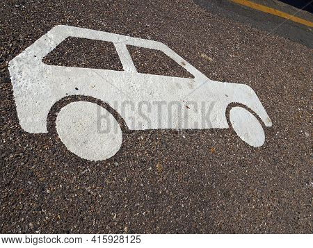 Parking Area Designated For Cars Only As Marked On The Asphalt