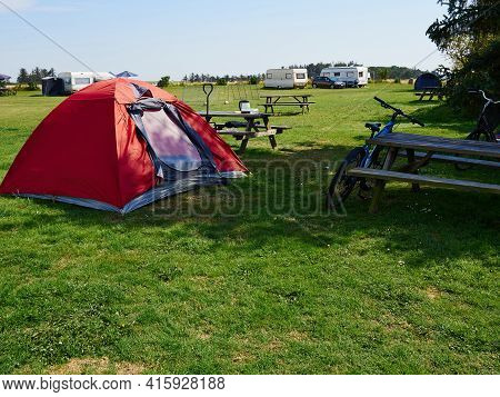 Red Tent For Primitive Vacation In A Simple Camp Camping Ground In The Middle Of Nature By The Ocean