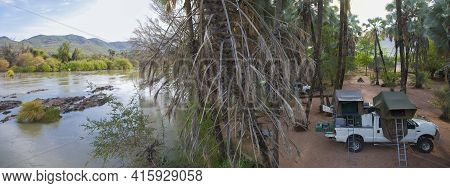 Epupa Falls, Namibia, January 8: Panorama Of The Campsite By The Kunene River At The Epupa Falls Wit