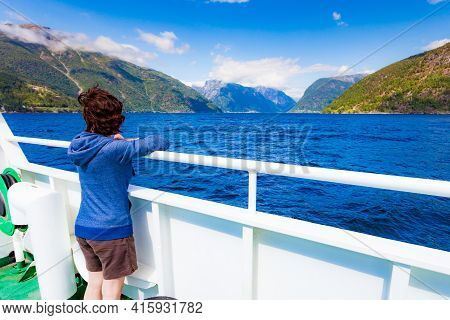 Tourism Vacation And Travel. Tourist Woman On Cruise Ship Enjoying Fjord Sognefjord View In Norway,