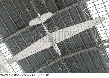 Moscow, Russia - November 28, 2018: White Plane or Glider model in Space museum. Inside The Cosmonautics and Aviation Centre in the Cosmos pavilion of VDNH. Aircraft exhibition. Rocket science