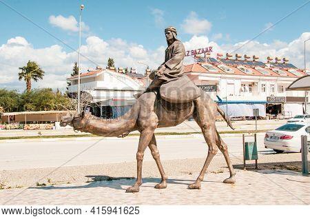 Evrenseki, Turkey - 03.16.2021 Element Of The Sculptural Composition Camel Caravan. A Camel Driver I