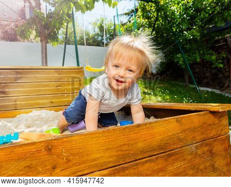 Cute Little Blond Boy Sit And Play In Sandbox