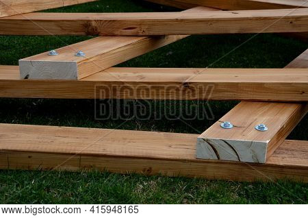 Beams Connected By Screws In The Shape Of V. Future Roof Of The Pergola Fixed To The Ground By Means