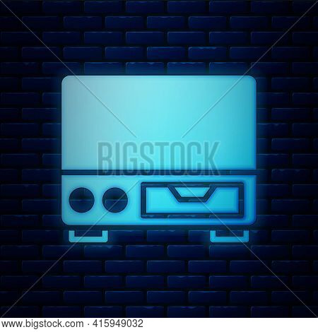 Glowing Neon Old Video Cassette Player Icon Isolated On Brick Wall Background. Old Beautiful Retro H