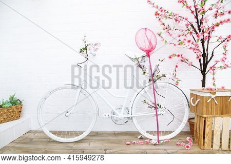 Retro Bicycle With Flowers On Background Of White House Shot From Front To Back Yard. Garden Decor I