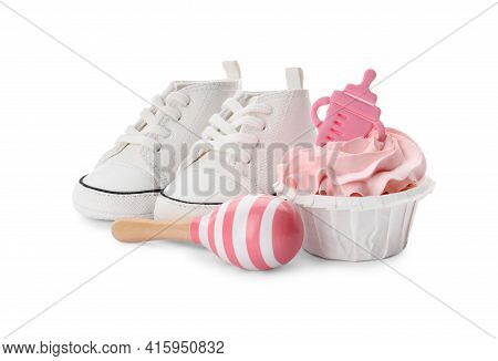 Baby Shower Cupcake With Pink Cream Near Shoes And Toy On White Background