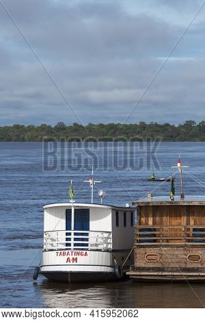 Small Harbor And Wooden Boats On The Amazon River In Brazil