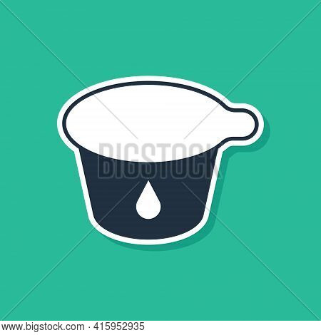 Blue Yogurt Container Icon Isolated On Green Background. Yogurt In Plastic Cup. Vector