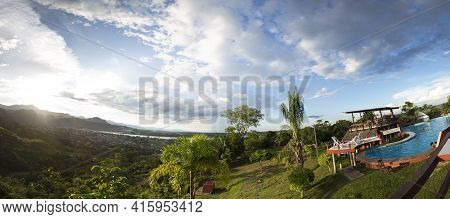 Rurrenabaque, Bolivia, January 7: Panorama Of Swimming Pool With Tourists With Tropical Mountains In