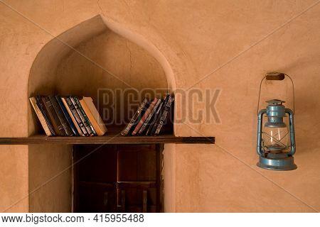 Nakhal, Oman - 04.03.2018: Room Of A Medieval Arabian Castle. Holy Books On The Shelf.