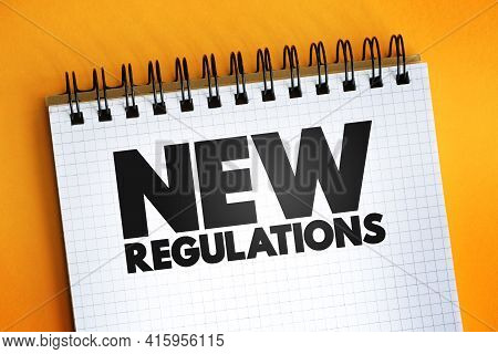 New Regulations Text Quote On Notepad, Concept Background