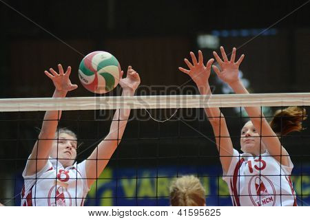KAPOSVAR, HUNGARY - JANUARY 27: Timea Kondor (L) in action at the Hungarian I. League volleyball game Kaposvar (white) vs Ujpest (purple), January 27, 2013 in Kaposvar, Hungary.