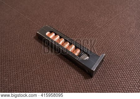 Copper Firearms Bullets And Pistol Clips. Weapon