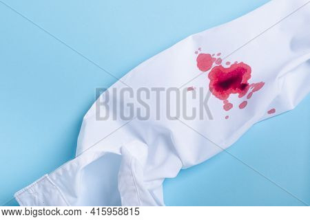 White Clothes With A Blood Stain. Concept Stain Removal. Concept Stain Removal