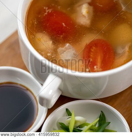 Pot Of Meat Soup Or Broth With Tomatoes, Sauce And Salad. Close Up Shot. Top View. Nutritious Wholes