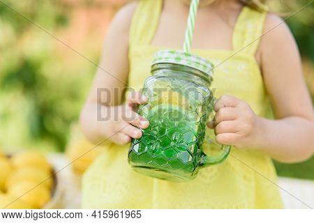 Child Girl Drink Natural Lemonade At Stand In Park. Summer Refreshing Natural Drink Lemonade. Detox