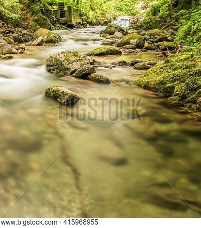 Forest River Stream In Summer Long Exposure Photo