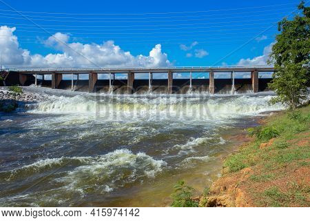 River Water Flowing Quickly Over An Overflow Dam