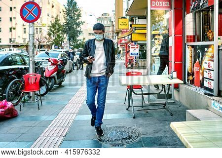 Antalya, Turkey - March 19, 2021: Young Man Uses Ppe When Outside, Since Region Is In Red Zone For C