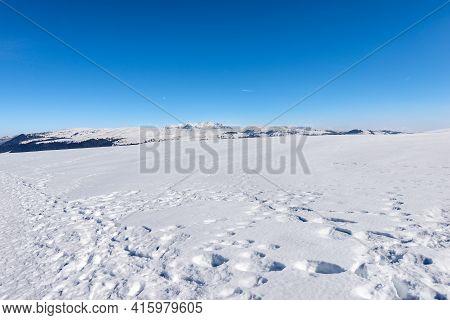 Lessinia High Plateau (altopiano Della Lessinia) And The Mountain Range Of The Monte Carega In Winte