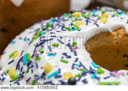 Easter. Easter Cake With Raisins And Icing Sprinkled With Colorful Sprinkles