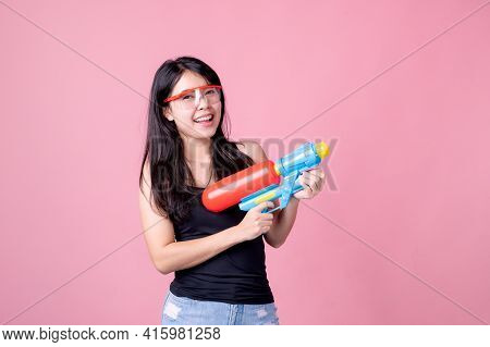 Beautiful Asian Women Hold Plastic Water Guns At An Ancient Temple During Songkran, The Most Beautif