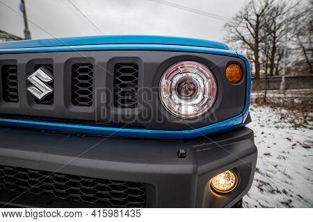 Moscow, Russia - January 24, 2020: Headlight Headlamp Of New Mini Suv Suzuki Jimny Static Photos In