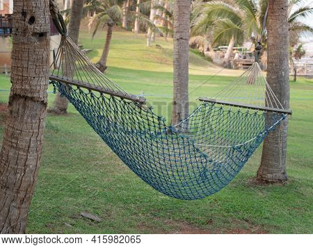 Tourist Hammock For Relaxing On The Beach. Hammock For Outdoor Holiday Recreation.