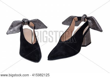 Womens Boots And Shoes. Closeup Of A Pair Elegant Female Suede High-heeled Shoes Decorated With Silv