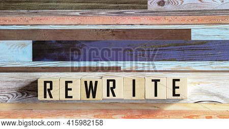 Concept Word Rewrite On Cubes On A Dark Wooden Background