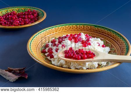 On The Table In A Ceramic Plate Delicious Natural Cottage Cheese With Red Currant Berries. Close-up,