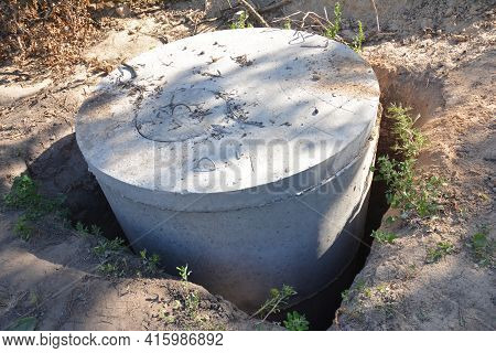 Septic Tank Concrete Ring, Concrete Manhole Sewer Installation Into The Pit. Septic Tank Constructio
