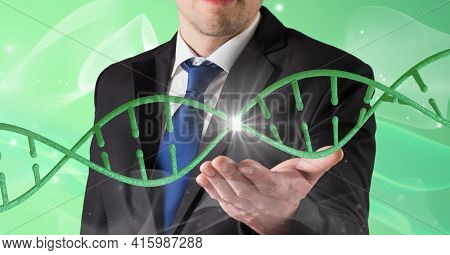 Dna structure over mid section of business man with cupped hand against green background. global business and medical research technology concept