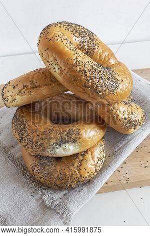 Some Delicious Bagels With Poppy Seeds On A Napkin Close-up. Front View.