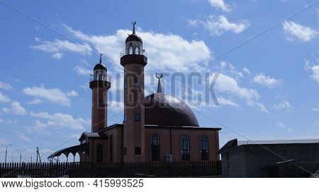 Beautiful Small Mosque With Two Towers And A Dome Decorated With Muslim Symbols, A Religious Buildin