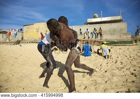 Saint-louis, Senegal, December 4: Unidentified Group Of Wrestlers Training On The Beach. The Senegal