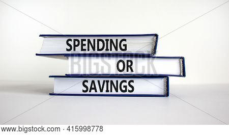 Spending Or Savings Strategy Symbol. Books With Words 'spending Or Savings'. Beautiful White Backgro