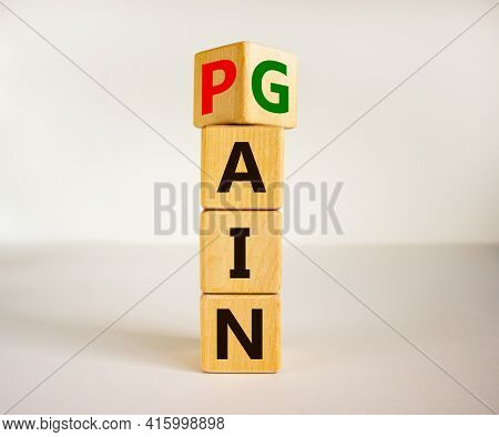 Pain Or Gain Symbol. Turned The Cube And Changed The Word Pain To Gain. Mindset For Career Growth Bu
