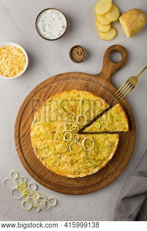 Quiche Pie With Leek, Potatoes And Cheese Flat Lay On Gray Concrete Background And Ingredients Chees