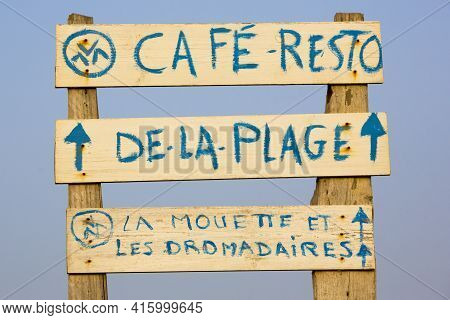 Sidi Kaouiki, Morocco - 25/08/2014:  Signs Advertising A Cafe On The Beach Of A Deserted Holiday Res