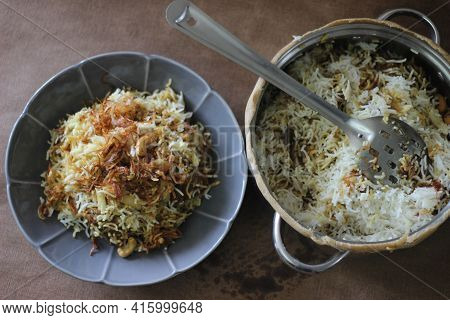 Mutton Biryani Served From The Pot After Breaking The Sealed Edges. The Edges Were Seled For Slow Co