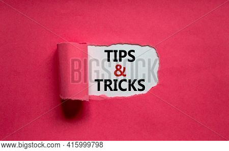 Tips And Tricks Symbol. Words 'tips And Tricks' Appearing Behind Torn Orange Paper. Beautiful Purple