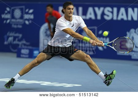KUALA LUMPUR - SEPTEMBER 27: Joao Sousa plays a return to David Ferrer during a quarter-final match at the Malaysia Open 2013 tennis played at the Putra Stadium, Malaysia on September 27, 2013.