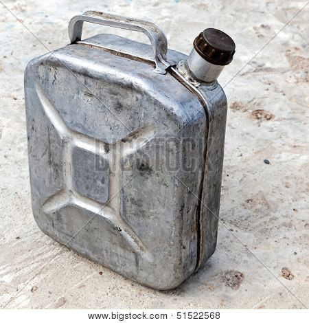 Old metallic 10l gasoline jerry can above concrete background poster