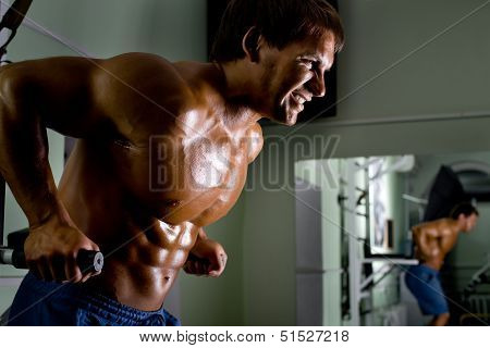 very powerful athletic guy exercises  in the gym poster