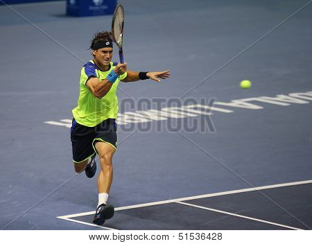 KUALA LUMPUR - SEPTEMBER 25: David Ferrer (Spain) hits a forehand return in a first round tennis match at the Malaysian Open 2013 played at the Putra Stadium, Malaysia on September 25, 2013.