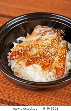 Japanese cuisine, eel with rice at black plate poster