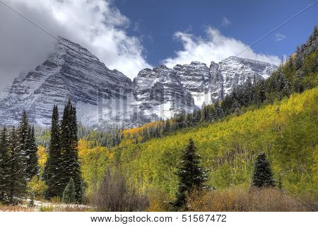Majestic Snow Covered Mountain With Yellow Aspens